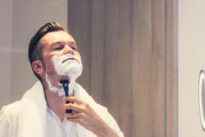 man shaving with shampoo