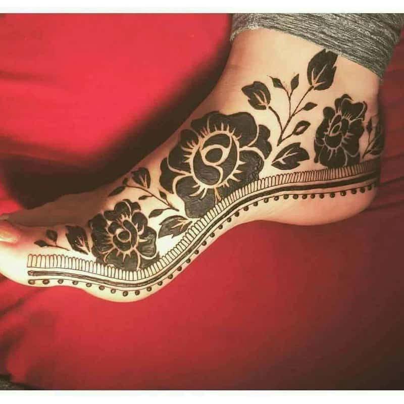 rose motif henna design on feet