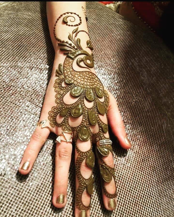 a peacock mehndi design on backhand