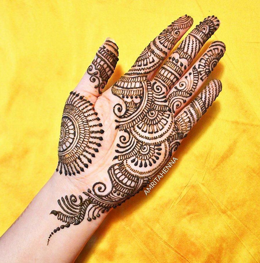 girl showing arabic mehndi design
