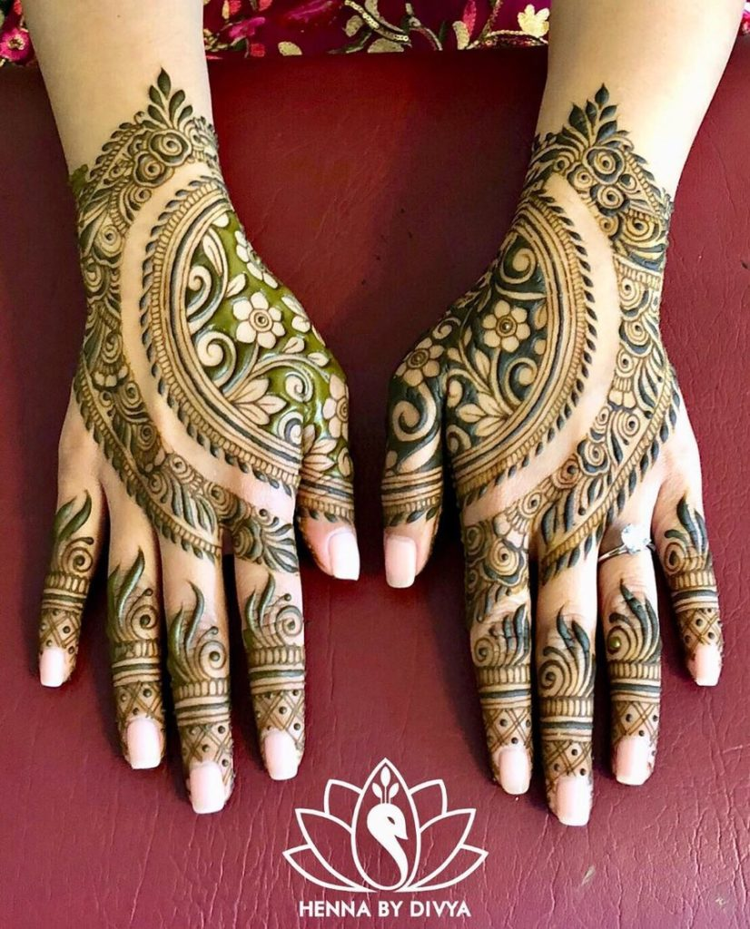 beautiful arabic mehndi design on back of the hand